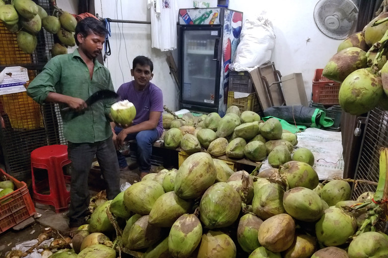 The coconut man was busy all night. It cost us about 40 cents for the privilege of watching him somehow not chop off his own arm before handing Brandon a freshly hacked coconut and a straw.