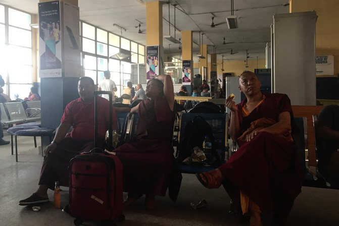 We heard the bus ride to Kathmandu could take 12 hours. Brandon wasn't up for that, so we booked a flight instead. We waited at the airport for quite awhile.