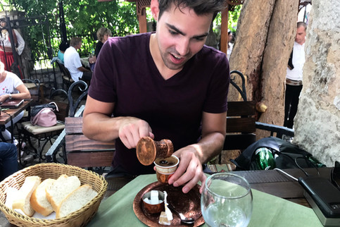 Brandon trying out the Bosnian coffee