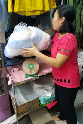 Laundromats are nearly nonexistant in Southeast Asia. Instead, you take your laundry to someone's house or other business (they'll have a sign outside advertising the price per kilo) and drop everything off.