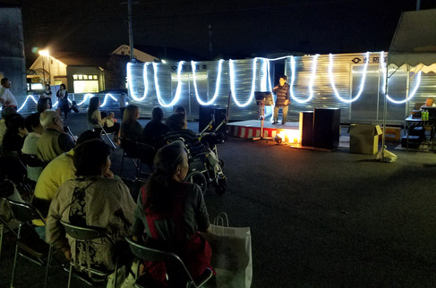 Our Airbnb host told us the town was putting on a festival and we could eat udon there, so we walked over for dinner. This was the karaoke stage.