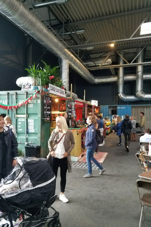 At an indoor food stall warehouse place