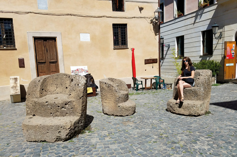 Stone chairs in the piazza