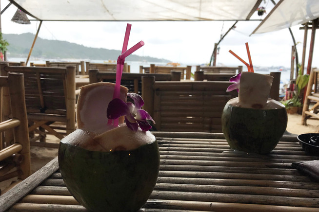 Coconut drinks on the beach in the rain