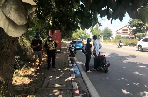 We were driving out of town to go to a waterfall when we ran into a problem: we got pulled over. Police look for tourists on bikes, who may or may not have international drivers licenses. We didn't know we needed one, but it turned out not to matter: if you have a license, you still need a permit from the Thai police.