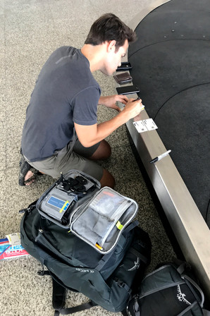 Filling out SIM card info on the baggage belt