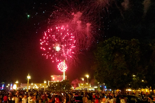 It was a bit surreal to walk around the city amidst thousands of people who had come for a festival we'd just learned about. There were food stalls everywhere, kids with toys running around, families camping anywhere they could find space, and giant fireworks displays.