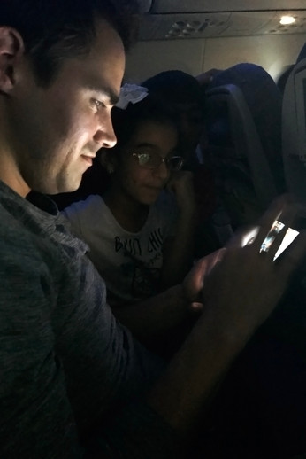The kids sitting next to Brandon asked him all about the kinds of games he has on his phone and his social media accounts.