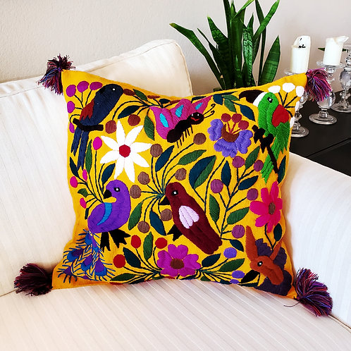 Chiapas Pillow Cover yellow fabric with colorful birds and flowers.