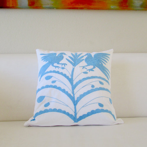 Otomi Pillow Cover light blue on white fabric.