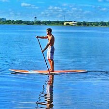 Young Man Paddleboarding near Davenport