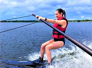 Young Woman Having Fun Waterskiing