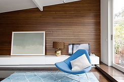 Horizontal wood panelling and blue occas