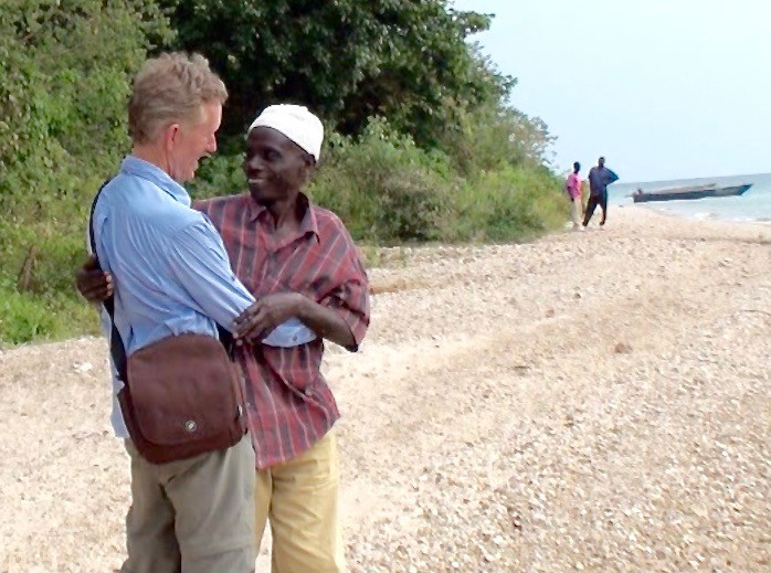 Reunion with Hamisi on Gombe Beach after thirty-six years. Photo by Thomas Crocker, 2009