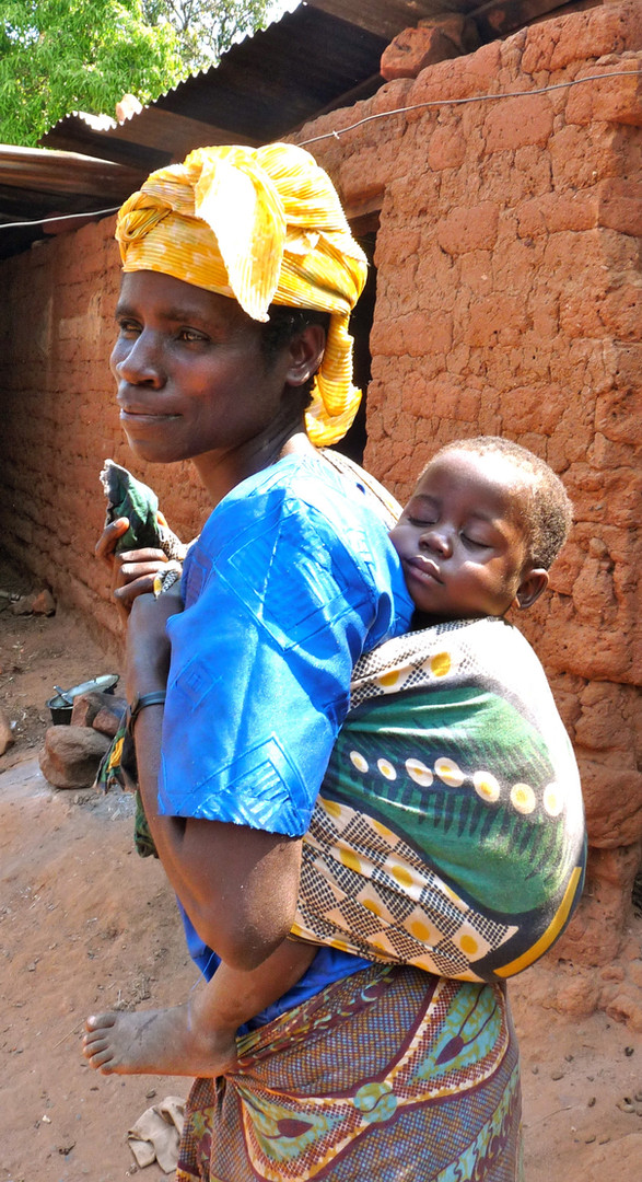 Mother and child, taken in Bubongo Village on our visit with Hamisi. Photo by John Crocker, 2009.