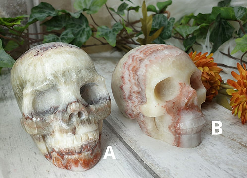 Tri colour calcite skull