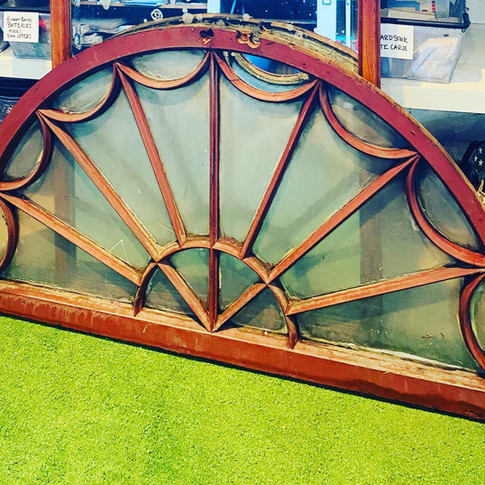 Curved gable window