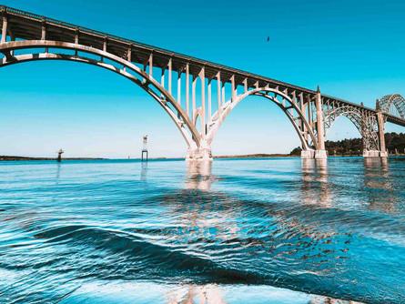 Newport, Oregon Coast - Low Tide Waves Beneath The Yaquina Bay Bridge