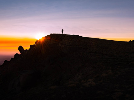 Steens Mountain, Eastern Oregon Desert - Person Standing Alone at the Top at Sunset