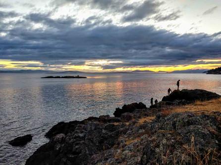 San Juan Island, Washington Coast - Family Climbing Over Rocks at Sunset