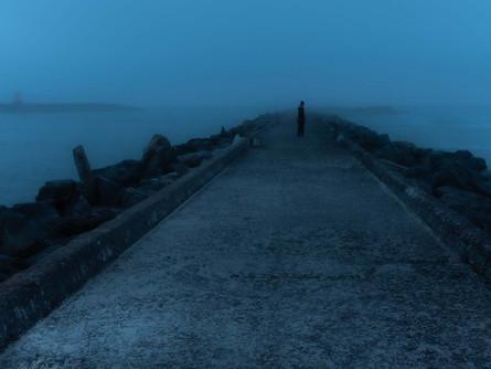 Bandon, Oregon Coast - Person Walking on a Dark Jetty Into the Alluring Fog