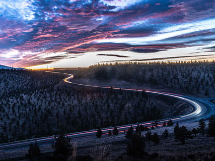 Central Oregon Desert - Purple Sunset Clouds and Car Tail Lights