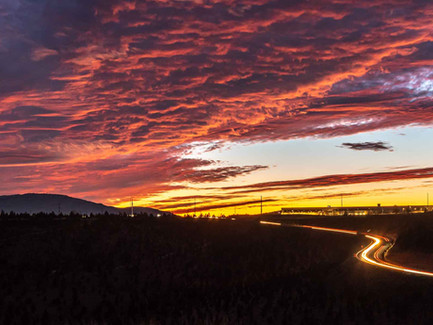 Central Oregon Desert - A Fiery Pink Night Sky with Red Car Light Trails