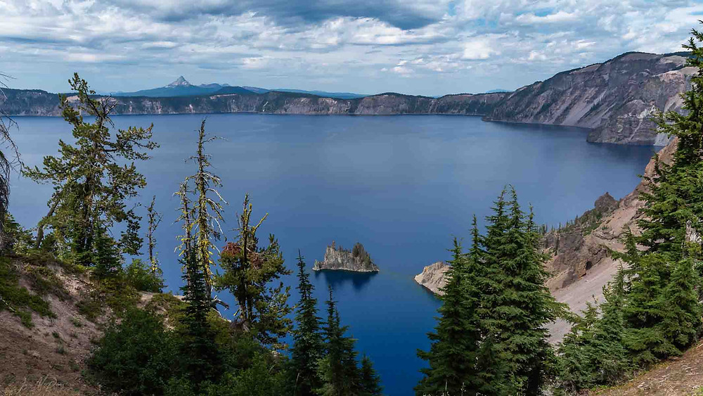Blue Crater Lake with Phantom Ship in foreground