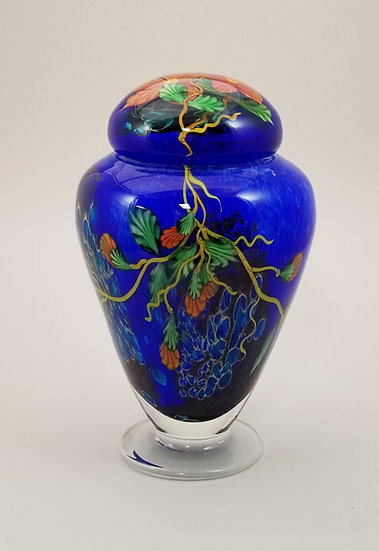 Blue urn with orange flowers and buds