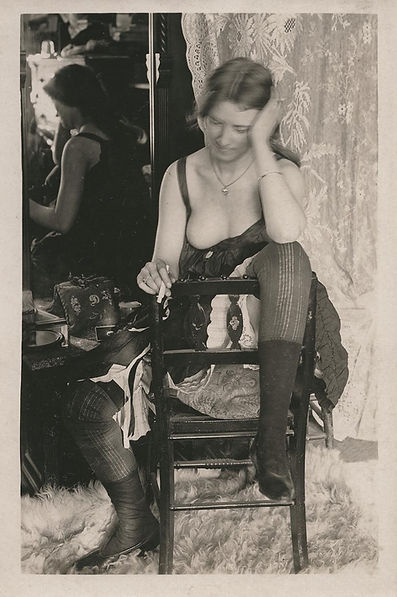 Vintage photo of a bordello girl in a chair