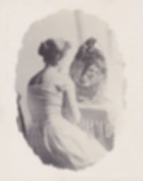 Vintage photo of a woman looking at herself in a mirror