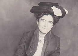 Old black and white photo of a woman wearing vintage clothing