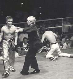 Jerry Trimble knocks down Mark Gurley with his trademark hook kick.jpg