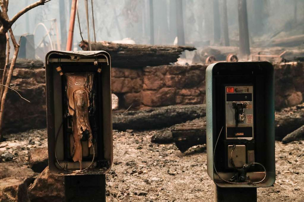 Melted metal phone booth and destroyed infrastructure at a Big Basin State Park campground after 2020 wildfires