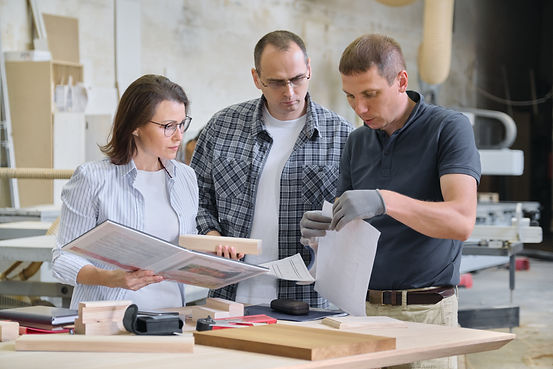 Team of woodworking workshop workers are