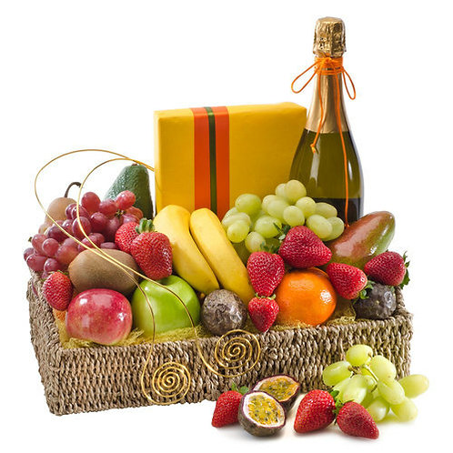 Fruit basket with sparkling wine and chocolates