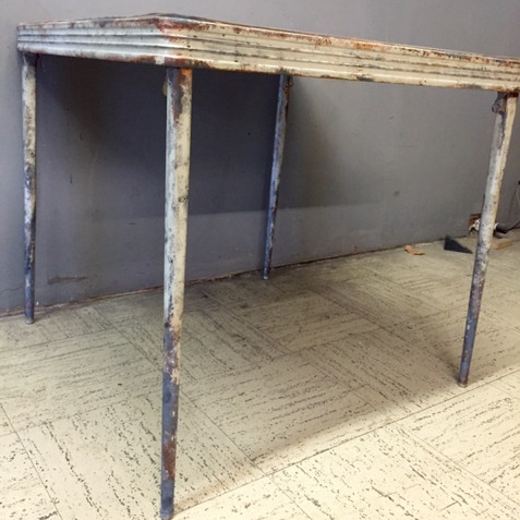 rusted card table