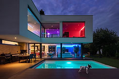 Modern villa with colored led lights at night. Nobody inside.jpg