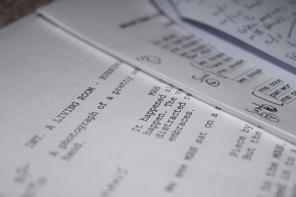 A close-up of pages of a screenplay that have been marked up in black pen.