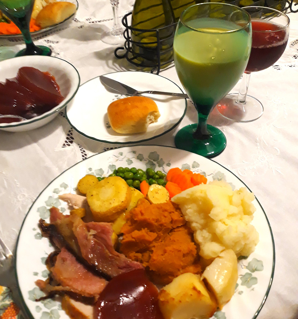 A Thanksgiving meal, including turkey, various potatoes, various veggies, and eggnog.