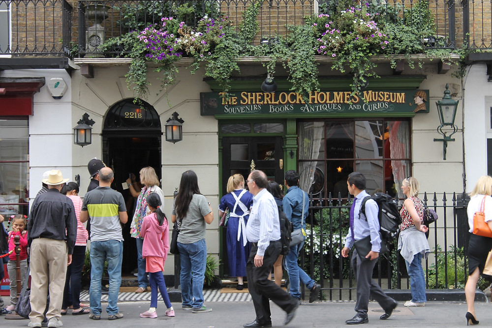 Pedestrians walk in front of the Sherlock Holmes Museum in London.
