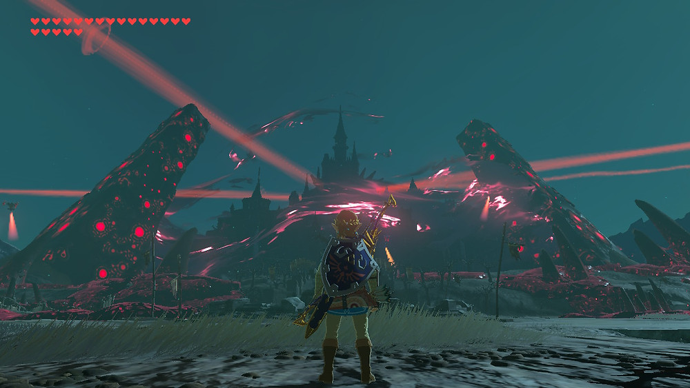 A screenshot from The Legend of Zelda: Breath of the Wild. Nighttime. Link stands with his back to the camera, facing a corrupted Hyrule Castle.