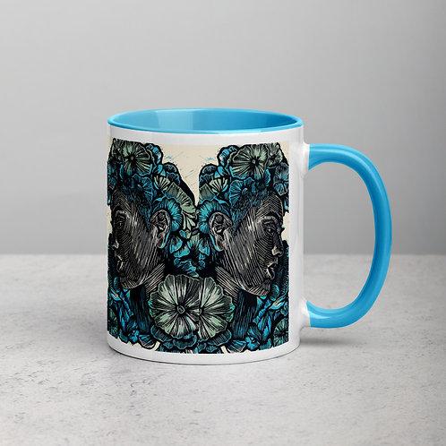 Resolute blue ceramic mug with a pop colour inside
