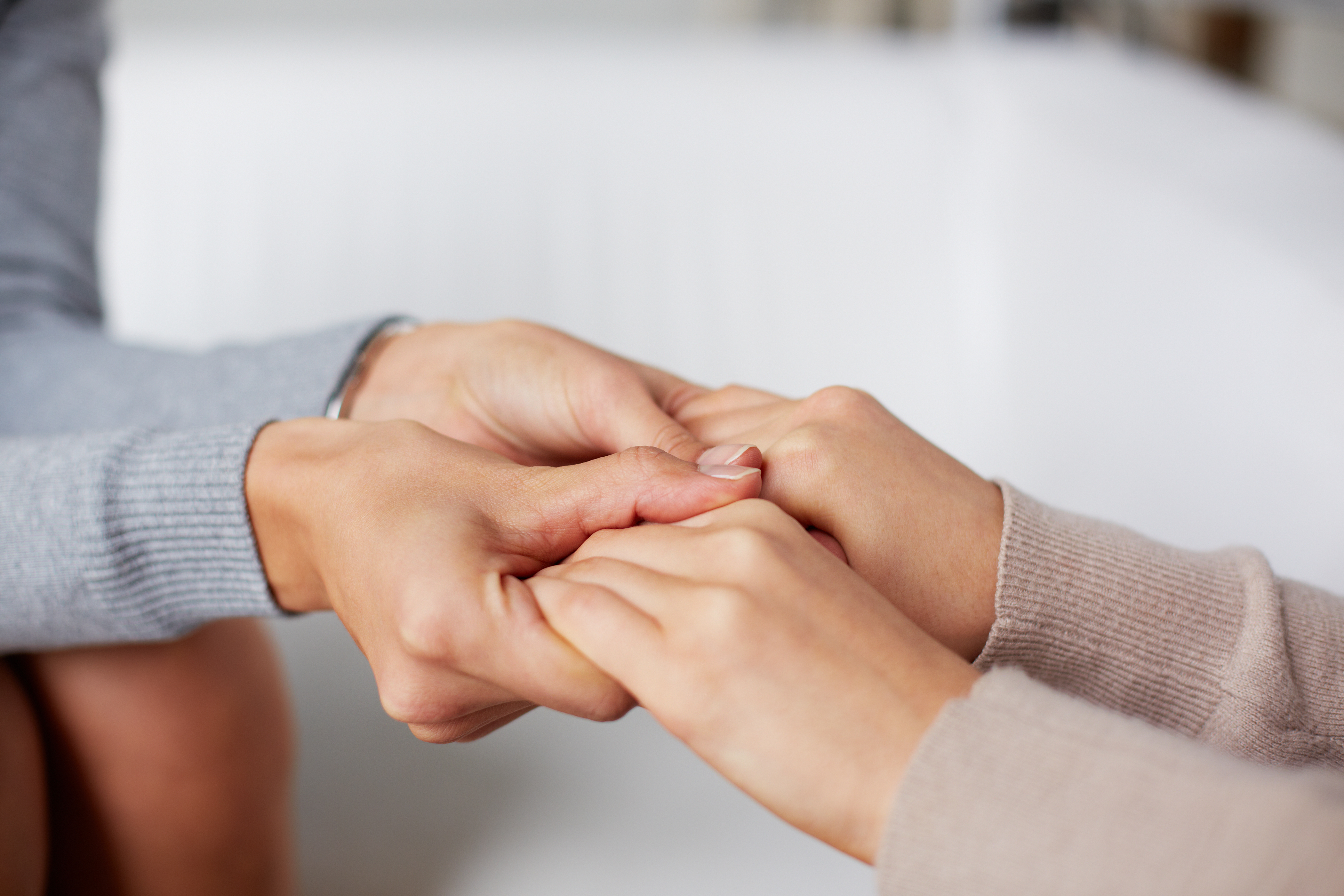 Close-up of psychiatrist hands holding t