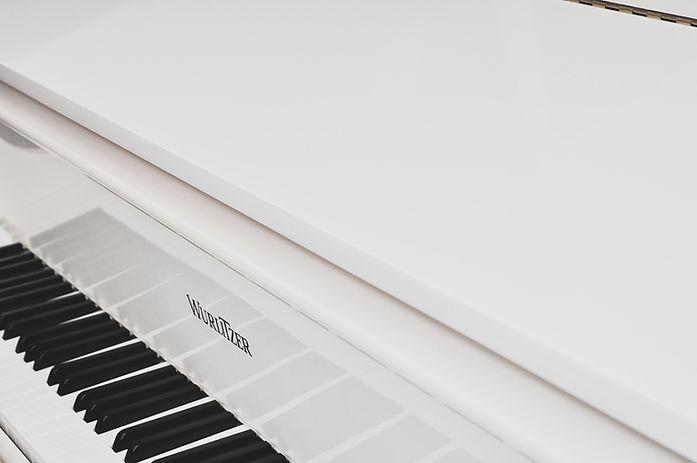 White Baby Grand Piano_edited.jpg