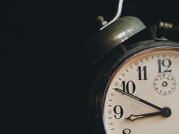 close-up-vintage-clock-alarm-on-background-with-co-5PYLDNA.jpg