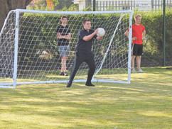 Football Goalie saving in the nets