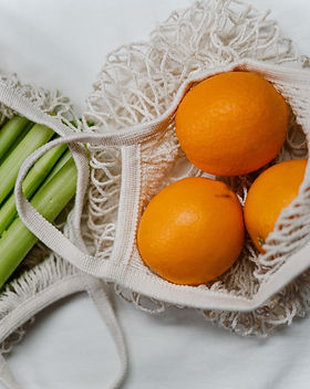 orange-fruit-in-white-net-bag-3737677 (1