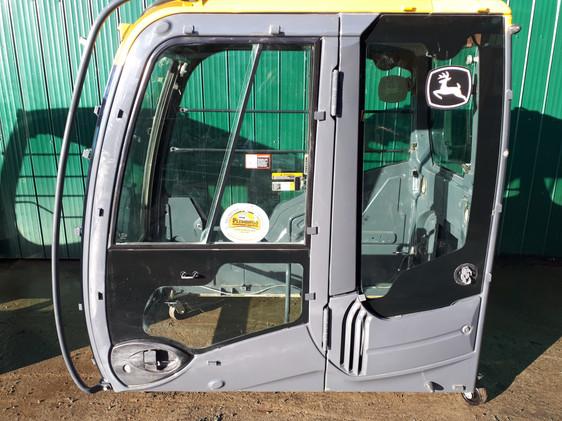 John Deere and Hitachi Cabs