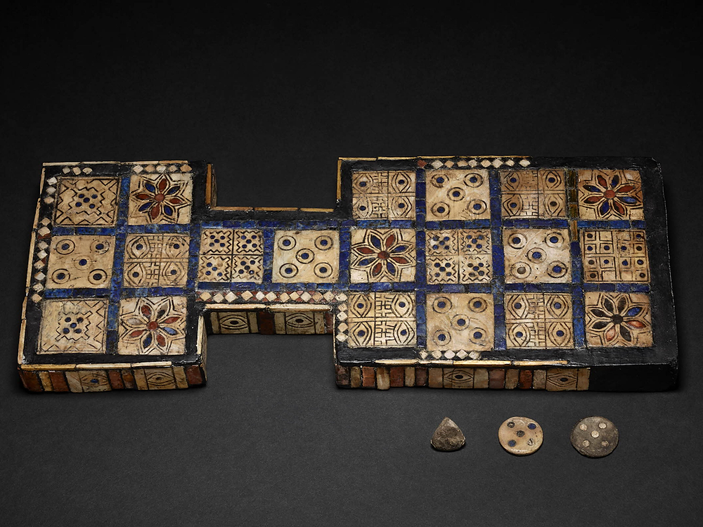 Royal Game of Ur board  found in Iraq by Sir Leonard Woolley in the 1926-1927 and dated to approximately 2500 BCE